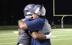 Love of the Game- Senior running back Kenan Lockhart hugs head football Coach Humberto Garza during game against Manor, which was the last of the season.