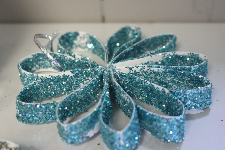 Studio 334 handcraft beautiful flowers from paper and glitter, which are now available for sale.