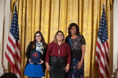Akins alumna Kassey Rocha (middle) and Olivia Tamzarian recieve award from First Lady Michelle Obama at the White House in November. The award recognized Mexic-Arte Museum's Screen It! afterschool program.