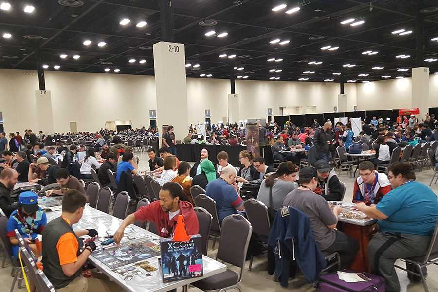 Fans of games like Dungeons and Dragons play the games they recently purchased with other attendees of PAX South in San Antonio.