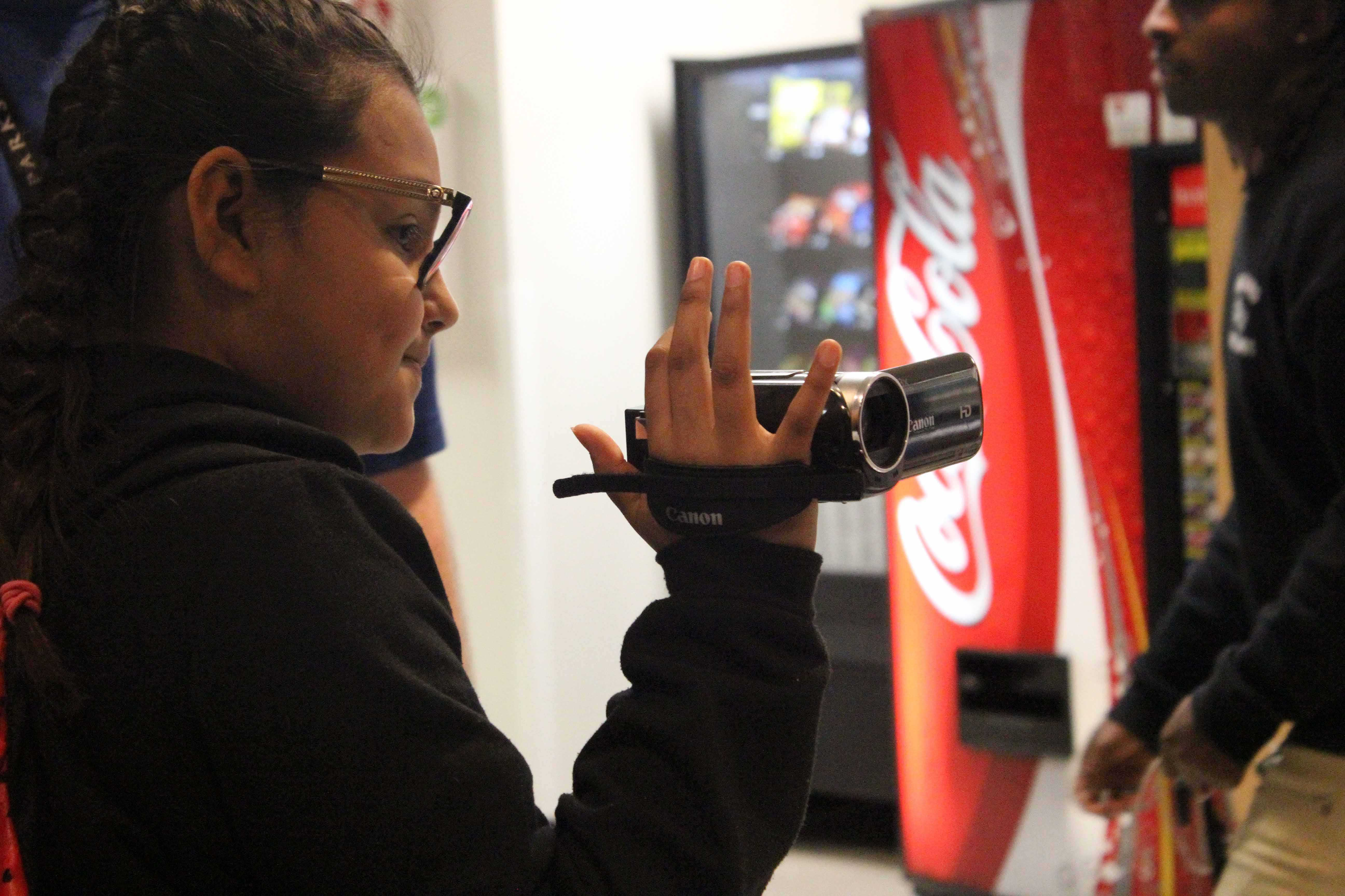 A sixth grader participates in recording and making Video Art. TCTA located in Dittmar Recreation Center helps teenagers expand their creativity.