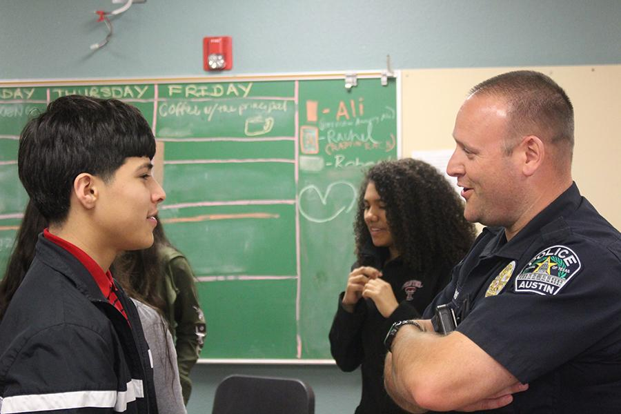 Officer Joshua Visi speaks to freshman Domanick Flores during a story sharing group activity. The Restorative Justice program has officers come in every Friday to build community relationships between officers and teenagers.