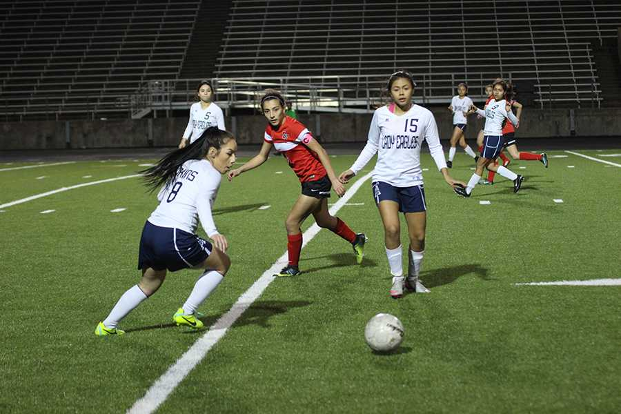 Captain Heidy Fuentes (right) and Itzel Moreno (left) work for possession of the ball against Del Valle.