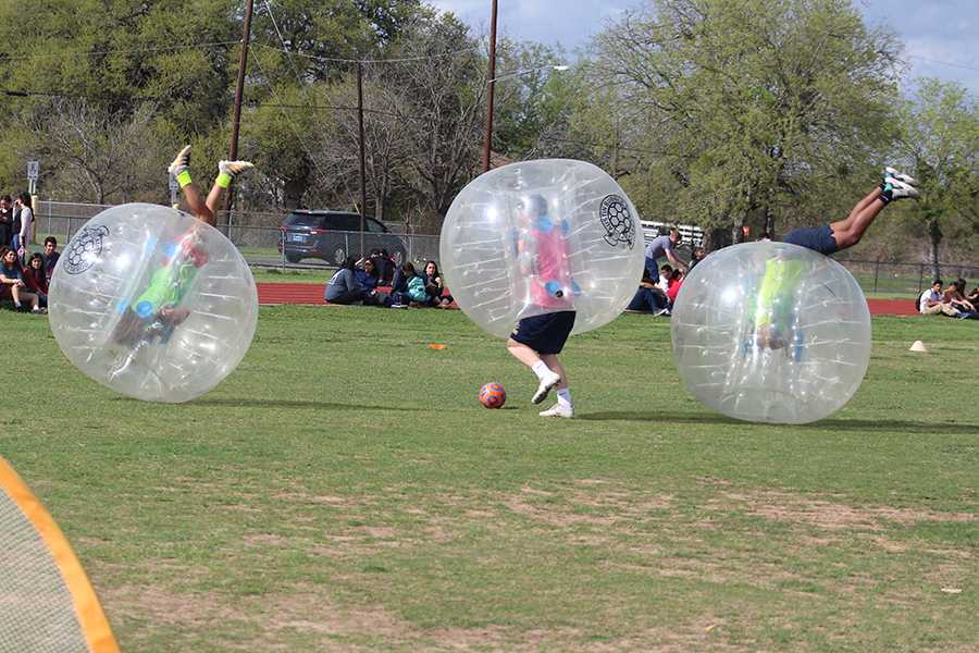 Two players roll out of control during the bubble soccer match on Thursday on the practice field. Players struggled to stay on their feet after hitting other players during the match.