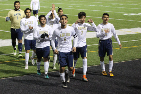 The boys Varsity Soccer Team celebrates after winning against the undefeated Del Valle Cardinals. The win helped secure a spot in the district 14 6A playoffs, which will begin after Spring Break.