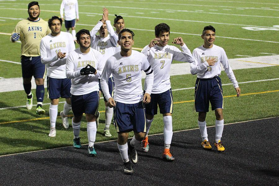 The+boys+Varsity+Soccer+Team+celebrates+after+winning+against+the+undefeated+Del+Valle+Cardinals.+The+win+helped+secure+a+spot+in+the+district+14+6A+playoffs%2C+which+will+begin+after+Spring+Break.