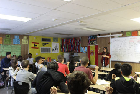 Spanish teacher Yareli De Paz Williams teaches her Spanish class with sign language. She uses sign language to help them remember and better prepare them for their exams.