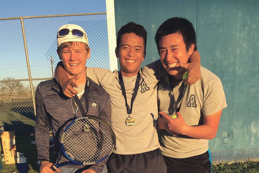 Connor+Harkins%2C+Simon+Carandang%2C+and+Kyle+Nguyen+pose+for+a+photo+after+their+big+tournament+sweep.