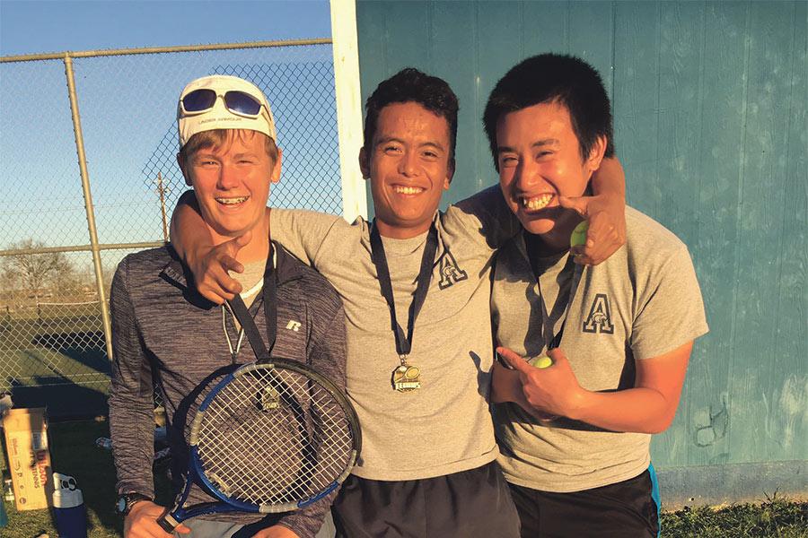 Connor Harkins, Simon Carandang, and Kyle Nguyen pose for a photo after their big tournament sweep.