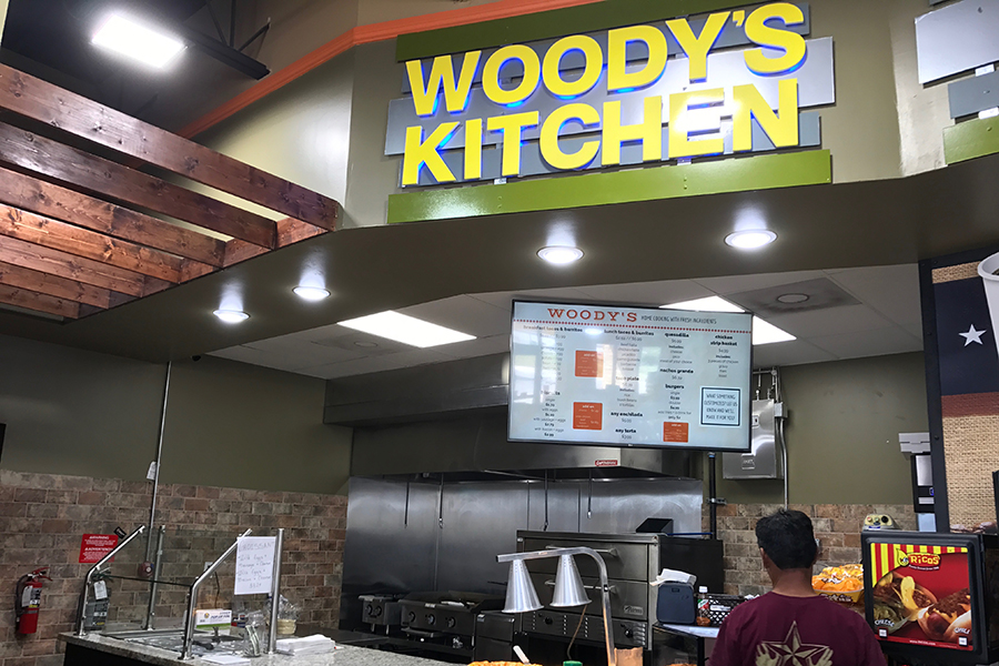 Woody%27s+Kitchen%2C+which+is+a+short+walking+distance+from+Akins%2C+is+a+convenient+alternative+for+seniors+who+don%27t+have+a+car+to+drive+to+other+off+campus+restaurants.