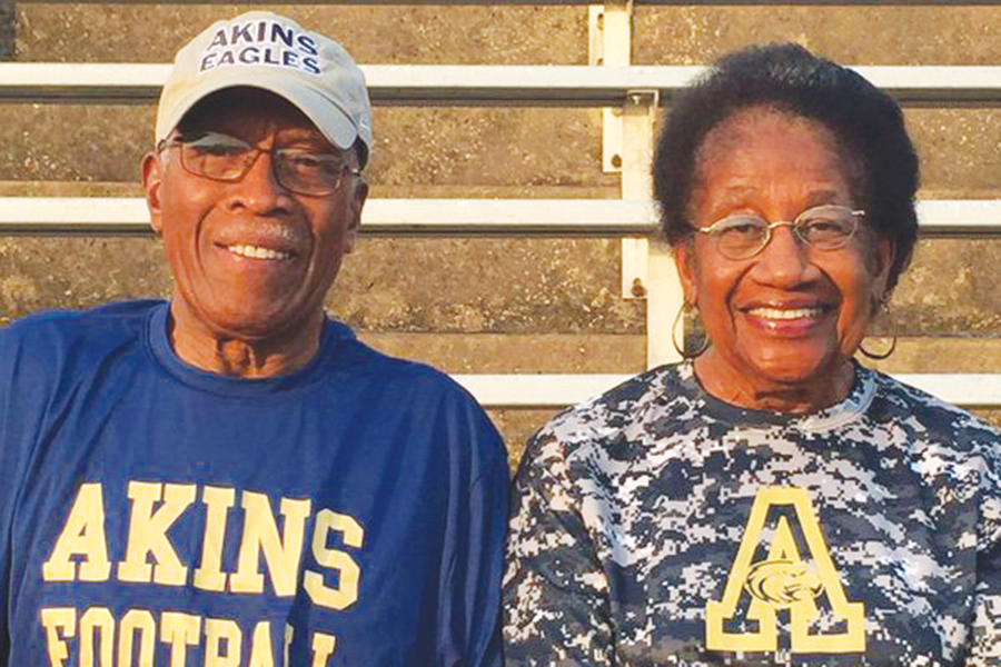 Dr.+and+Mrs.+Akins+sit+in+the+stands+at+Burger+Stadium%2C+Akins+cheered+for+the+Eagles+on+and+off+the+field+as+often+as+he+could+