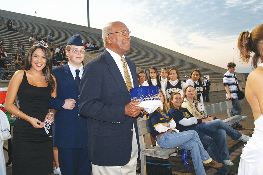 Dr.+Charles+Akins+stands+ready+to+present+the+homecoming+king+with+his+crown.+Akins+was+always+involved+with+school+events+