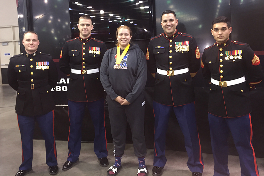 Katerina+poses+with+Marine+Corps+soldiers%2C+after+earning+the+All-American+title