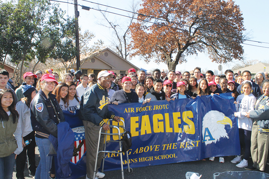 Dr.+Charles+Akins+poses+proudly+with+JROTC+members+and+volunteers+at+the+end+of+the+annual+Martin+Luther+King+Jr.+parade+in+East+Austin