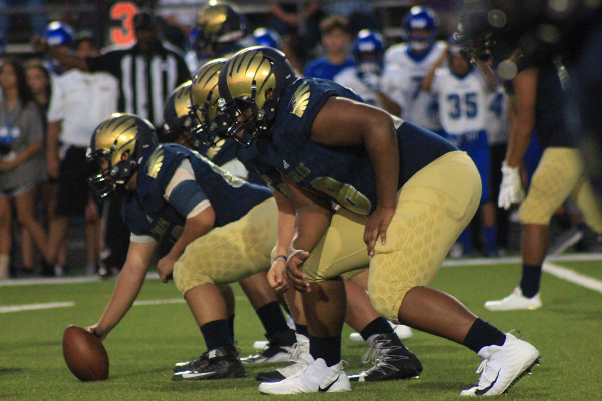 Akins+offense+lineman+prepare+to+prepare+to+score%2C+with+the+football+in+one+of+the+players+hands.