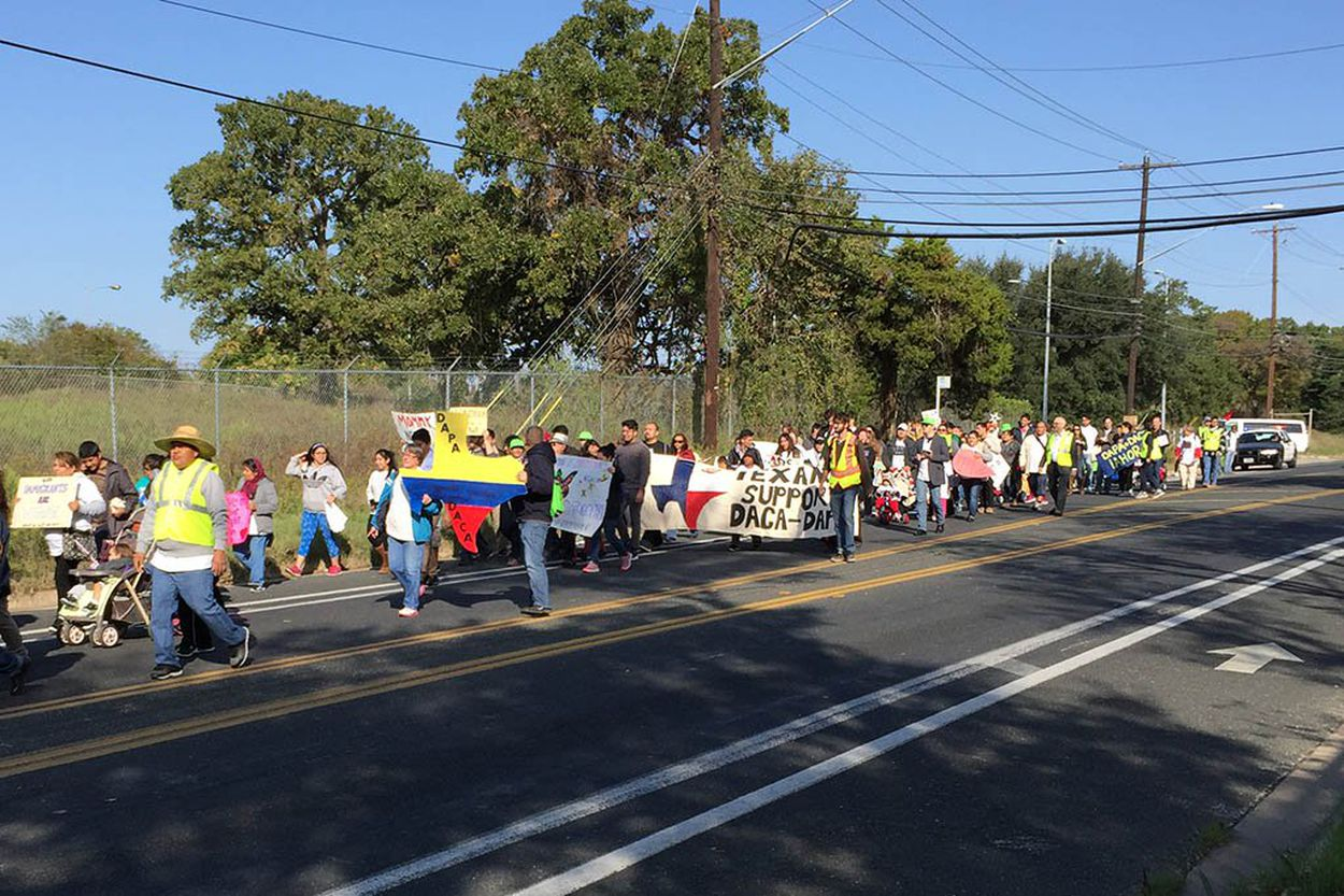 Activists nearing the end of their 37-mile march from a federal detention facility to the Texas Governor's Mansion on Nov. 21, 2015.