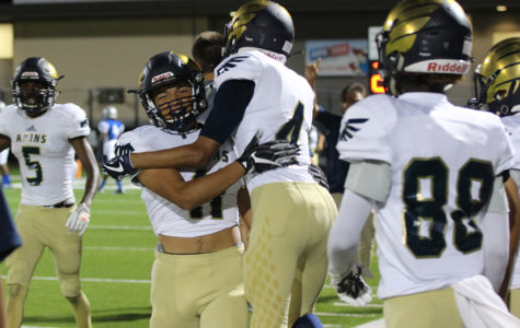 Senior Santana Castillo (11) and Senior Andy Zamora (4) celebrate a touchdown pass against McCallum on Sept. 21 at House Park. Despite the loss to the Knights, the Eagles found reasons to celebrate.