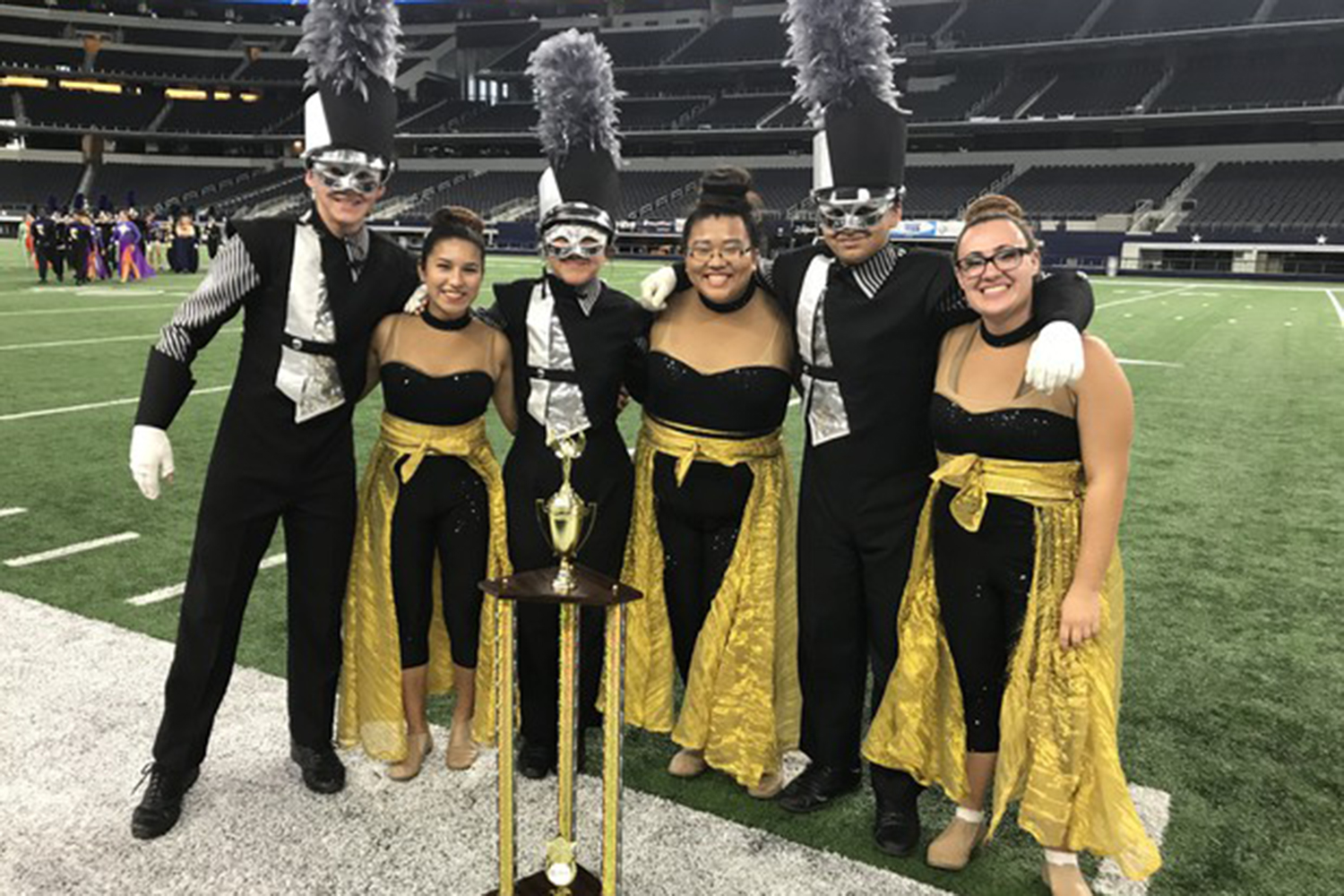Drum Majors and Guard Captains celebrate at the USBands Southwestern Championships in Dallas, TX on Saturday Oct. 21.