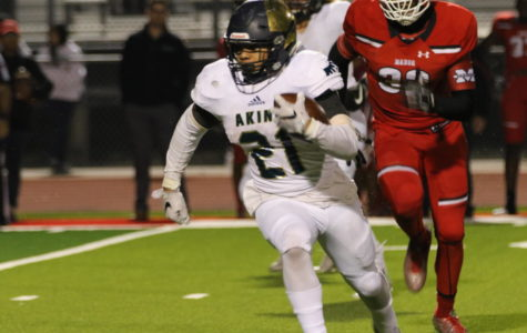 Malcom Rodgers runs for a play against the Manor Mustangs during the final regular season game. The Eagles beat the Mustangs that night in the final seconds of the game, earning the Akins football team their second appearance in district playoffs in school history.