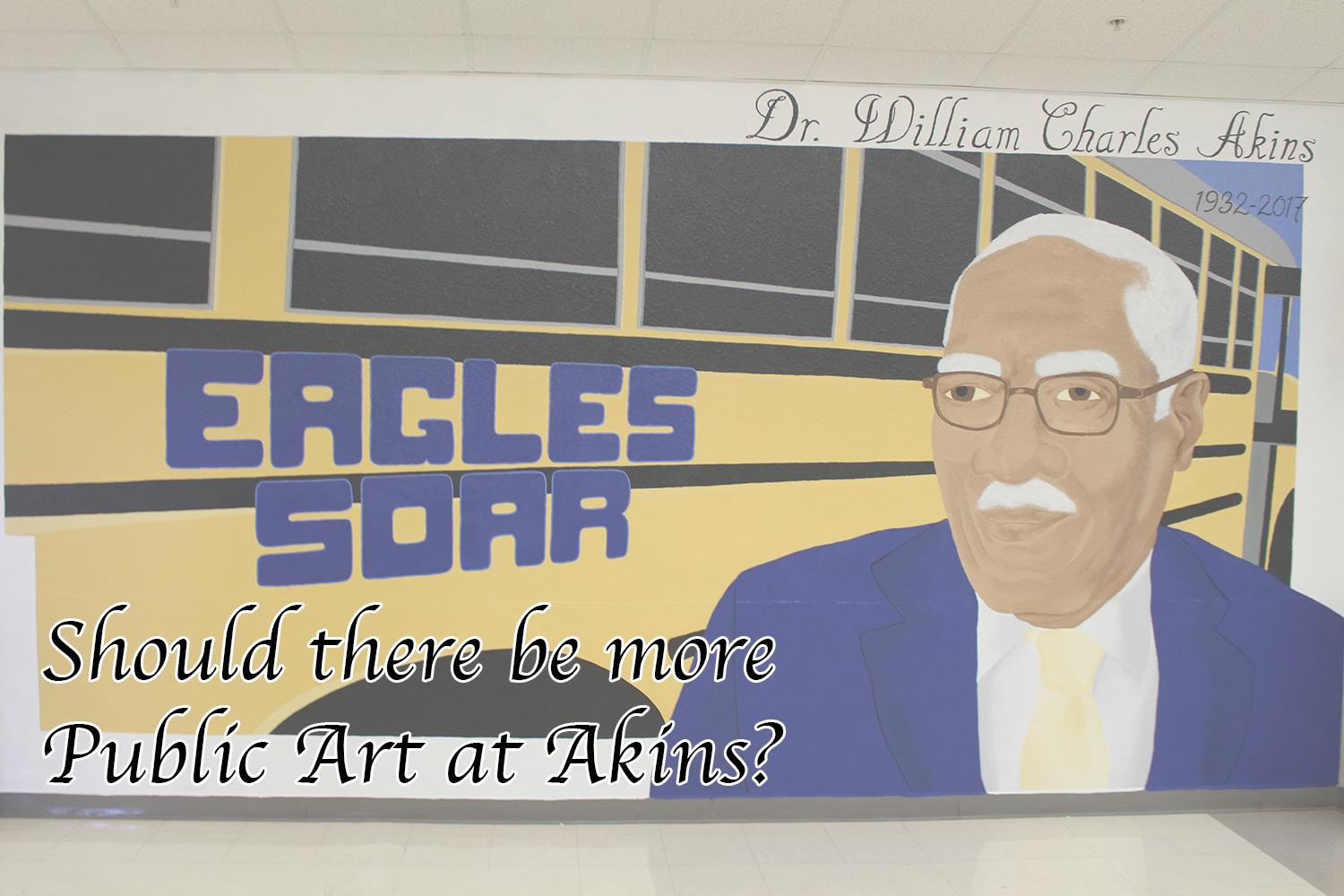 A mural of school namesake Dr. W. Charles Akins greets students near the main entrance. It was recently painted after administrators removed unused lockers from the wall.