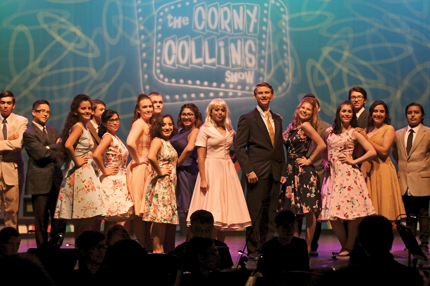 Performers on the Corny Collins Show pose as if they were on a live television show as part of the Akins Journey Theater programs production of Hairspray.