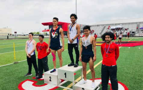 Track and field relay team breaks numerous school records at meet