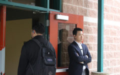 Assistant principal  Michael Jung monitors students as they enter the STEM wing before school starts. Administrators and security personnel were seen in greater numbers after the lockdown event in February.