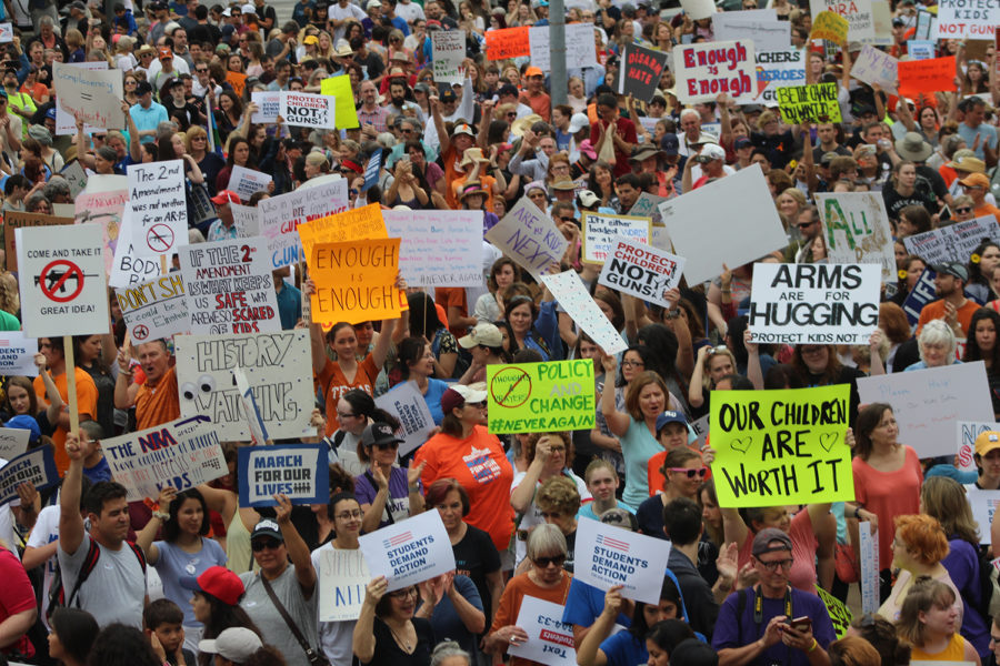 Many+citizens+wave+signs+to+show+what+they+believe+should+happen+to+reduce+gun+violence+in+America+at+Austin+City+Hall+before+beginning+the+march+to+the+Texas+Capitol.