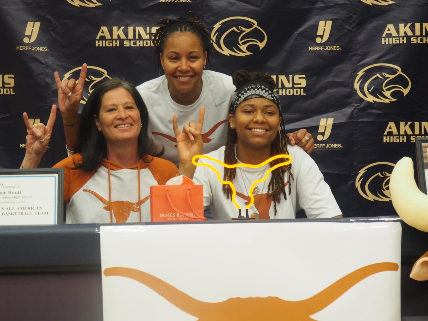Shae Routt poses for a picture as she finished signing for the University of Texas at Austin.