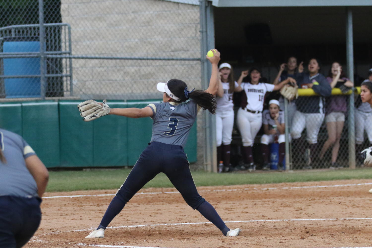 Senior Ivelisse Moreno throws a pitch for the opposing team's batter. The varsity softball team was the district champion this season, with a 8-2 record for the year.