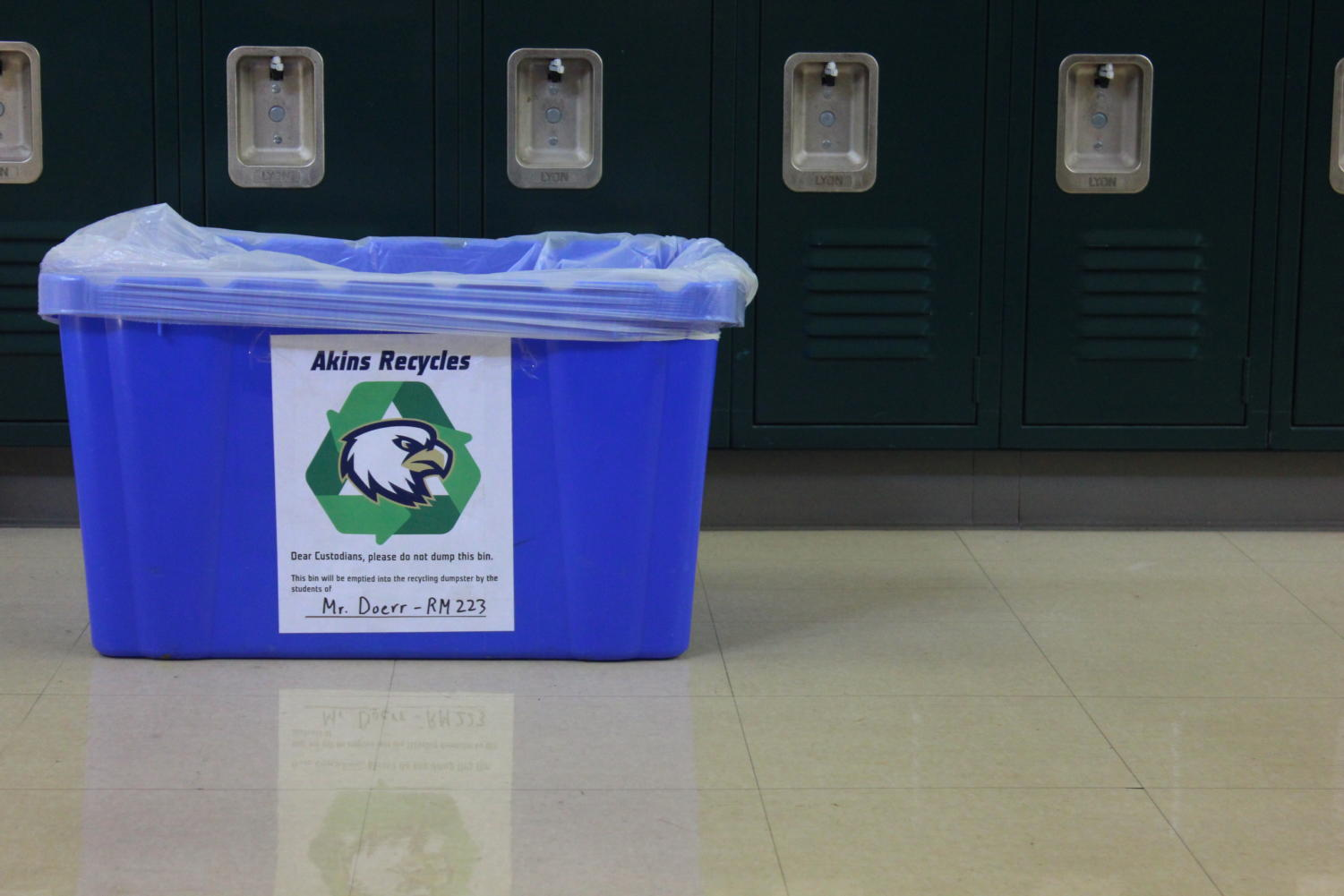 Newspaper advisor David Doerr's recycling bin which has a sign placing the responsibility to recycle on students