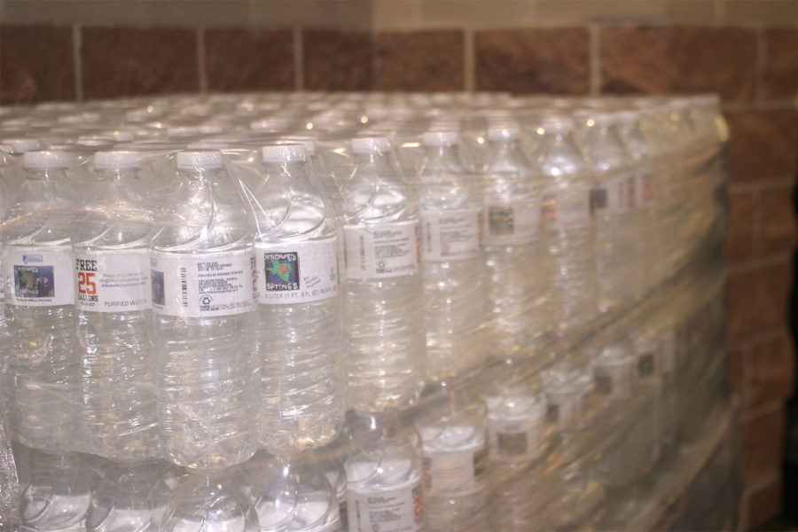 Administrators+distributed+cases+of+water+to+the+students+for+drinking+water.
