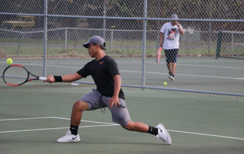 Tennis team works to improve season, makes it to district