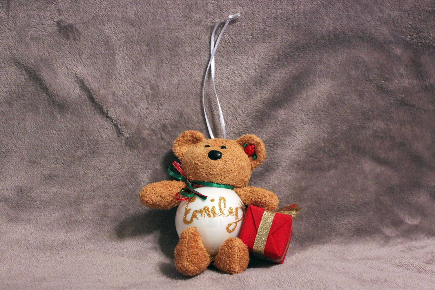 This beanie baby teddy bear was converted into an ornament.
