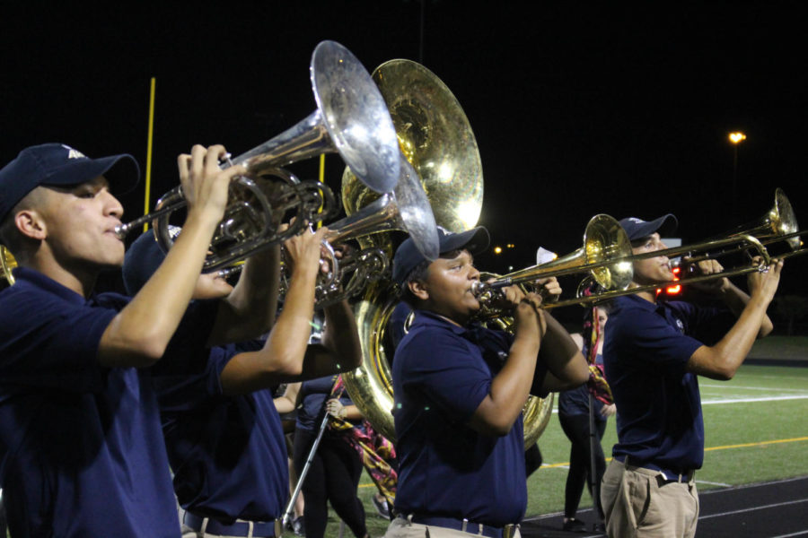 A+group+of+band+members+playing+on+the+field+during+halftime.%0AThey+performed+at+the+Akins+and+Crockett+game.