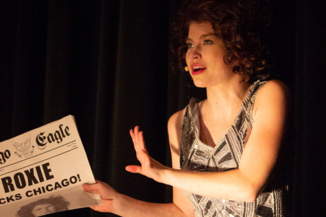 Roxie Hart (played by Kacey Wasson) speaks on her appearance in the newspaper.