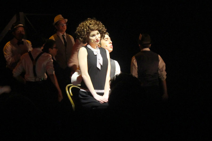 """Sophomore Kacey Wasson and Macedo performing """"We Both Reach for the Gun"""" as Roxie Hart and Billy Flynn. Wasson acted as a puppet in the scene."""