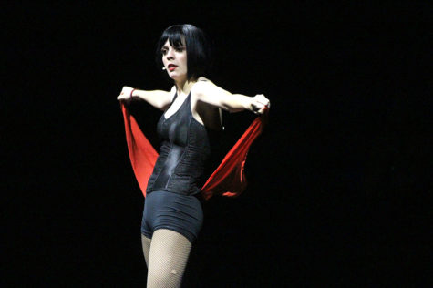 "Sophomore Coral Rolon, playing Velma Kelly, performs ""Cell Block Tango."" The Kelly character is upset that Roxie Hart character for upstaging her fame in the Chicago newspapers."