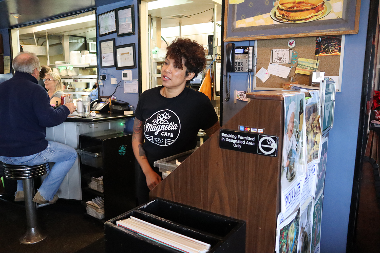 Ebone Zamarron works a hosting shift at Magnolia's Cafe to earn extra cash to help provide for her two daughters. She also works another job for some extra spending cash.