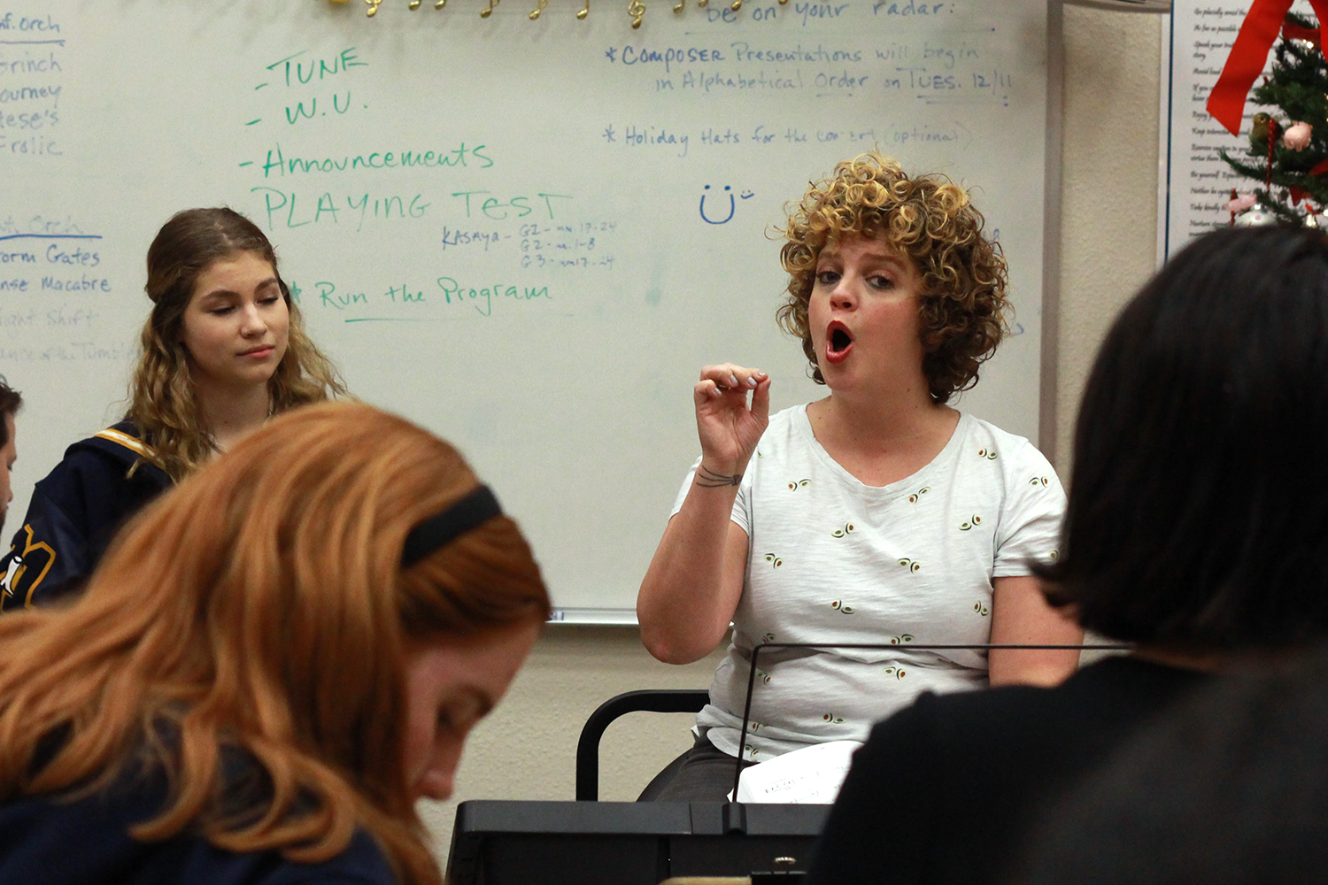 Vocal coach Tara Gillespie works with cast members for the high school version of Chicago. The coaches were brought in at the beginning of the year to assist students with music and dance for the musical, which opens on Thursday.