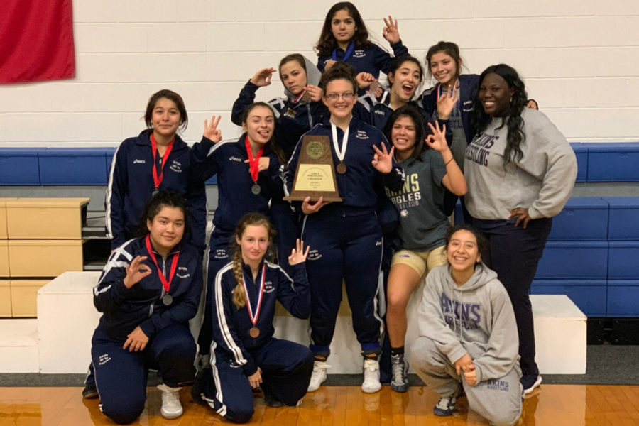 The+girls+varsity+wrestling+team+won+the+district+championship+on+Feb.+8.+Ten+Akins+wrestlers+will+advance+to+compete+at+regionals+this+weekend.