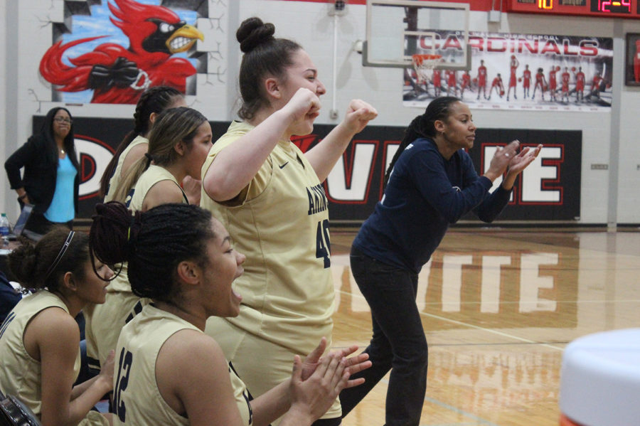 Freshman+Melanie+Cantu+cheers+on+her+team+in+a+game+against+Del+Valle.+Akins+beat+Del+Valle+57-51+sweeping+them+for+the+season.