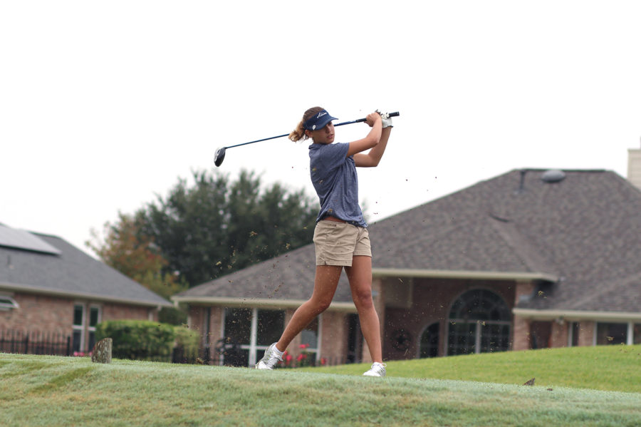 Freshman+Riley+Romero+tee%E2%80%99s+off+to+start+off+her+golf+tournament.+She+worked+to+finish+as+a+top+freshman.