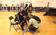 Track team receives shoe donation before new season