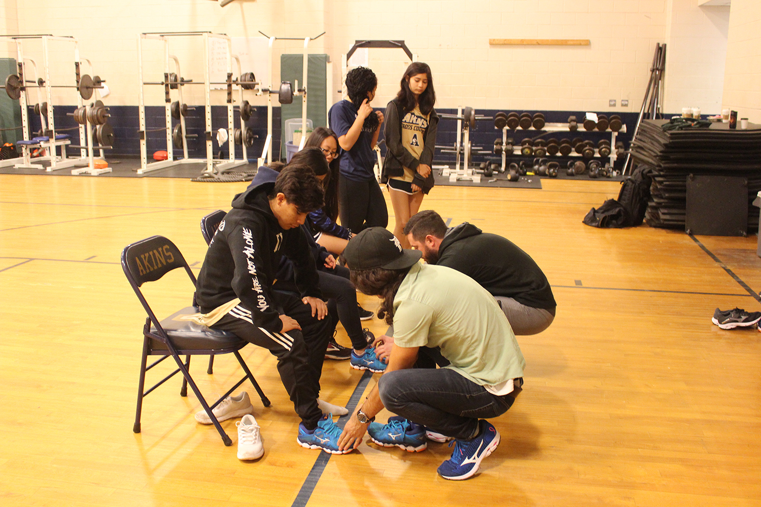 Members of the track team tried on brand new running shoes provided Feet Fleet for the track season in January. The shoes are designed to provide runners with proper support while running.