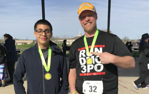 Yearbook teacher Sean Claes congratulates freshman Jordyn Aguilar for beating his time in the SoChac 5K race. Claes boasted that he was the