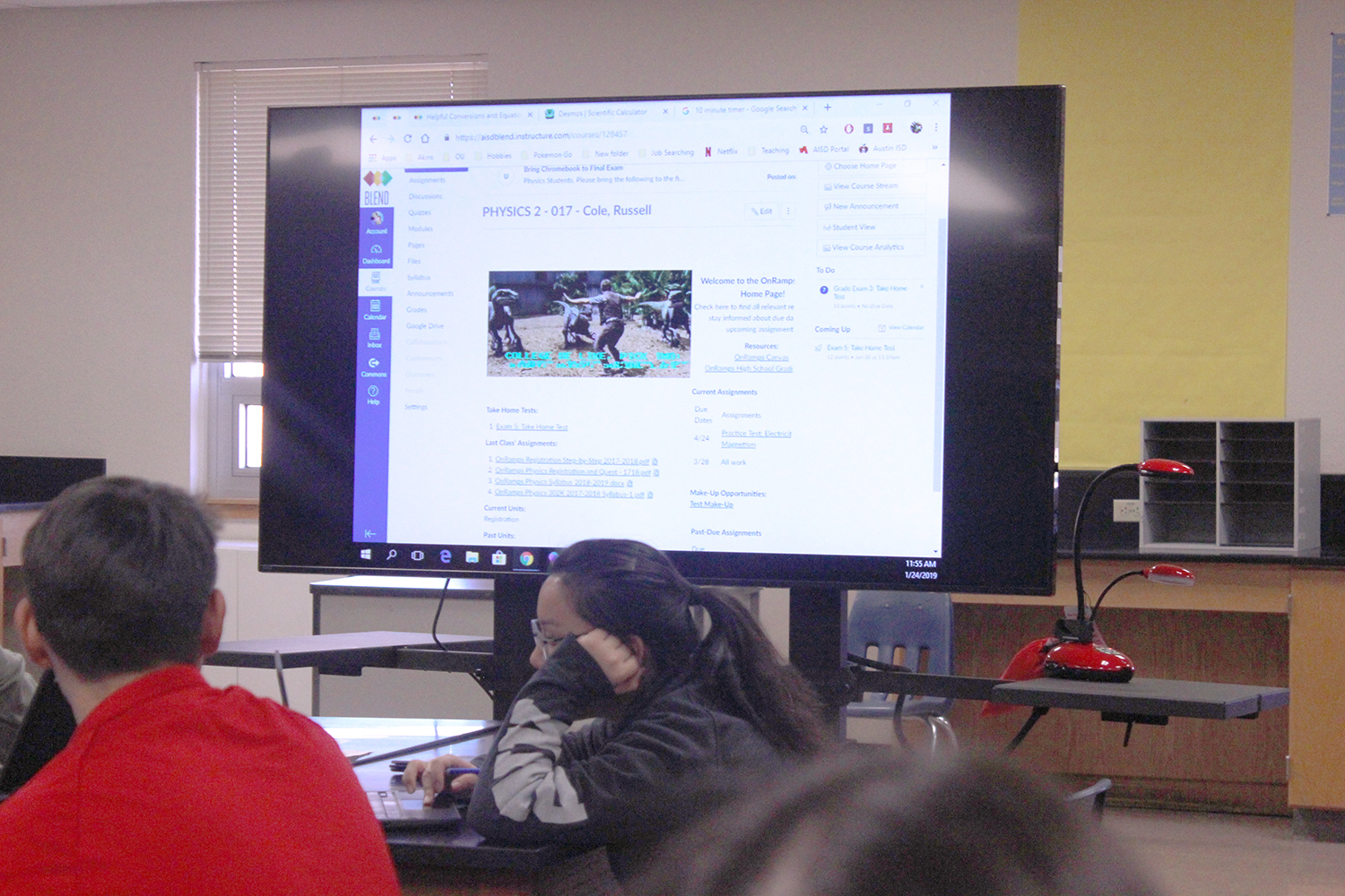 Students watch as a physics teacher uses his EduDisplay to guide students through a daily assignment. The TVs arrived in classrooms in January.