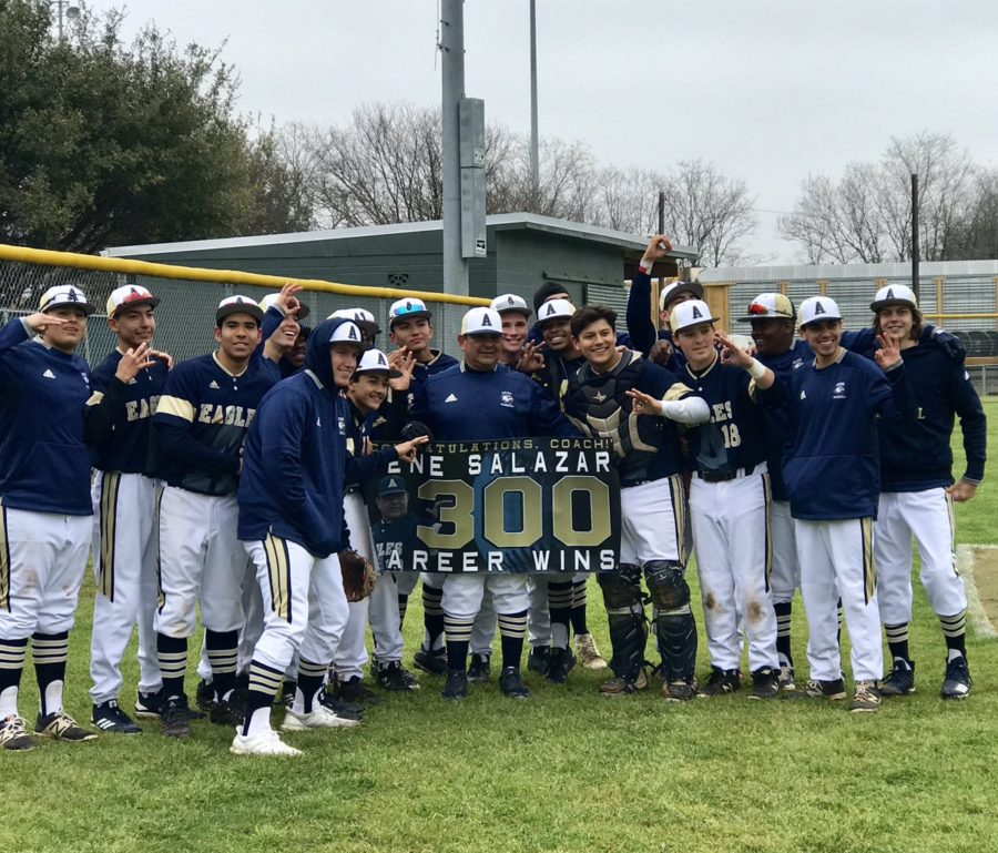 Head+baseball+coach+Eugene+Salazar+and+the+baseball+team+show+off+a+banner+celebrating+Salazar%27s+300th+career+win.+The+Varsity+Baseball+team+defeated+Leander+High+School+11-3%2C+earning+the+distinction+for+Salazar.