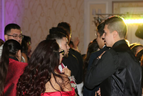 Students socialize at the 2018 Prom, which was held at the Austin Marriott South. Faculty class sponsors recently warned members of the Class of 2019 that they need to raise more money to pay for prom and other senior-year activities.