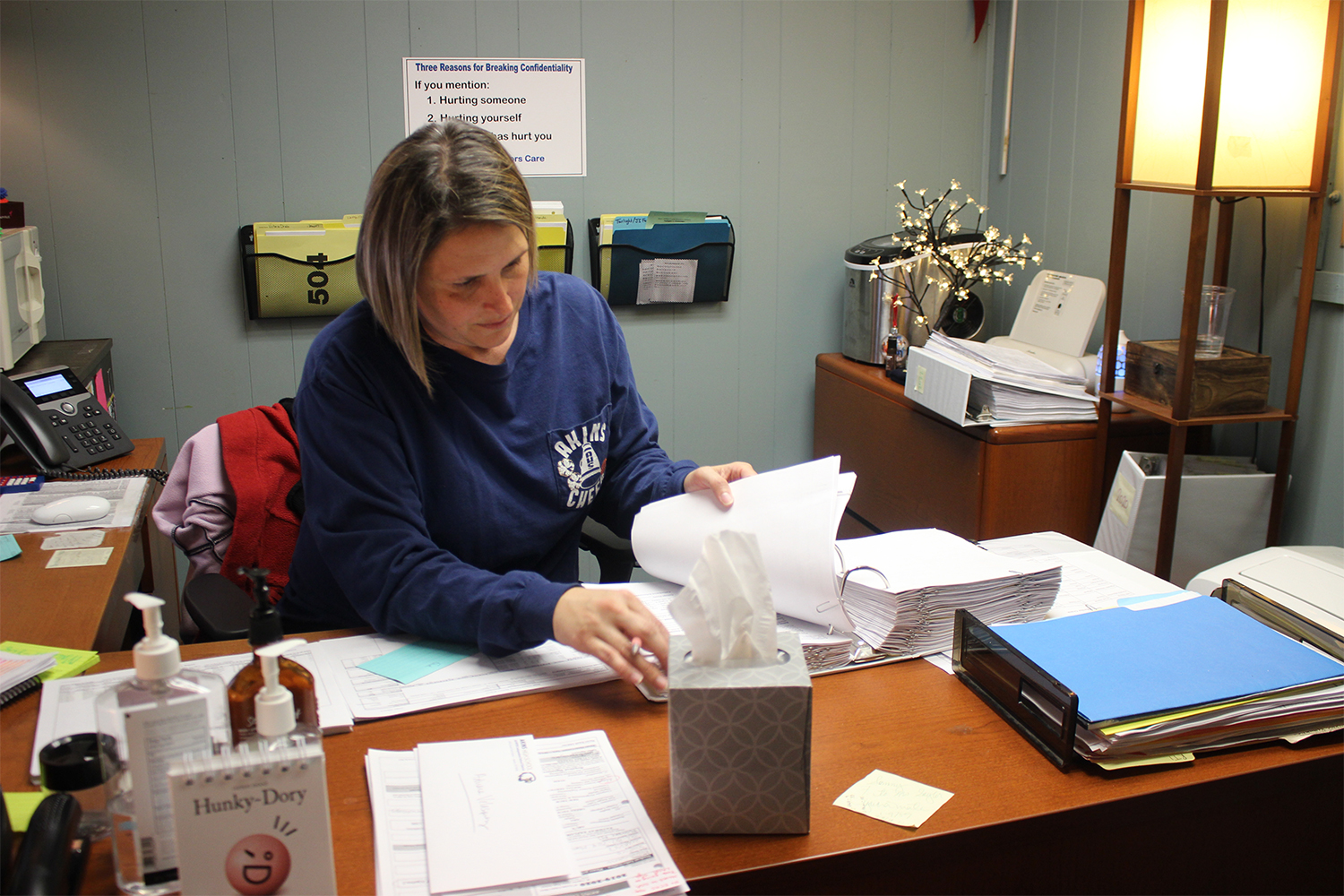 Jacey Saylor-Carroll, counselor for the Social Services Academy, reviews paperwork she uses to keep track of student progress. All Akins counselors struggle with caseloads above the ratios recommended by the American School Counselor Association.